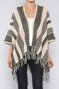 Our racks are chock o' block full of our best selling ponchos, wraps and cardigans! For information on pricing or how to purchase, please email themasonjarsf@gmail.com.